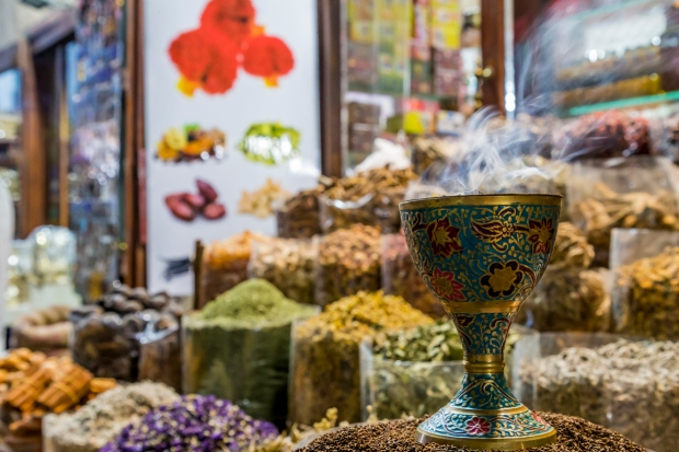 Vibrant shops selling colourful textiles and spices at the Manama Souq in Bahrain